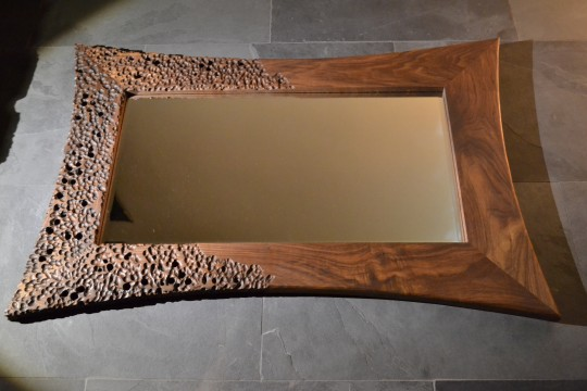 Volcanic walnut mirror. POA.