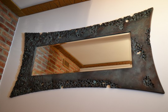 Volcanic oxidised windy copper mirror. POA.