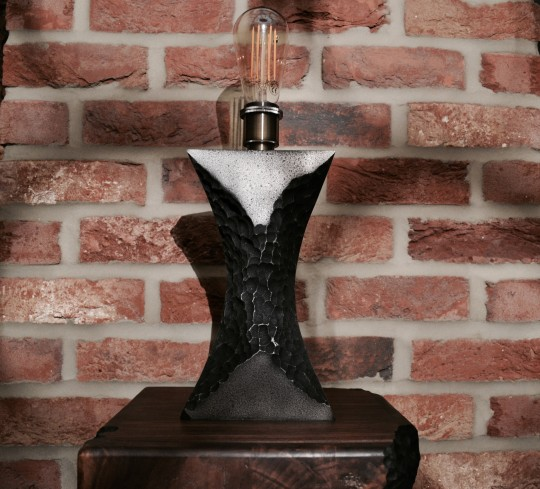 Volcanic cast aluminium table lamp. POA.